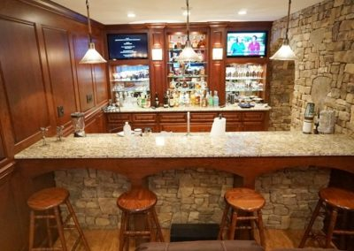 Beautiful wood and stone bar in remodeled basement